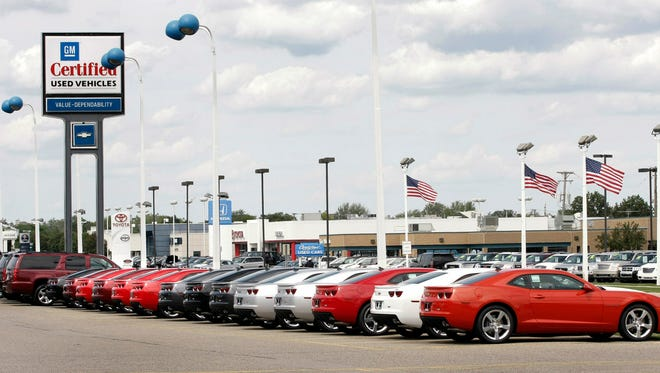 Various cars sit in the lot for sale at a General Motors used car dealership at the Troy Motor Mall in Troy, Mich., in this file photo