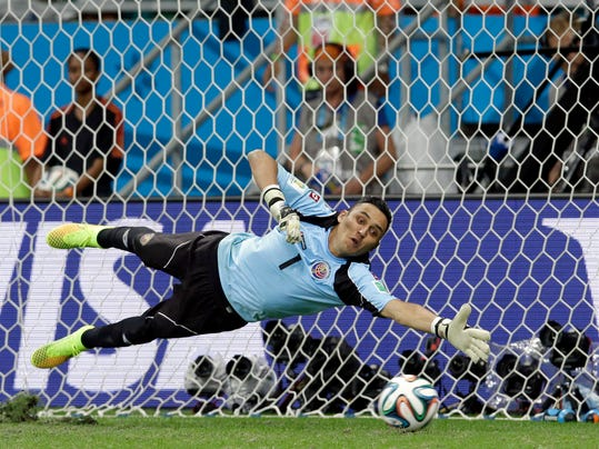 Costa Rica's goalkeeper Keylor Navas dives trying to save a penalty kick during penalty kicks at the World Cup quarterfinal soccer match between the Netherlands and Costa Rica at the Arena Fonte Nova in Salvador, Brazil, Saturday, July 5, 2014. The Netherlands won 4-3 on penalty kicks. (AP Photo/Hassan Ammar)