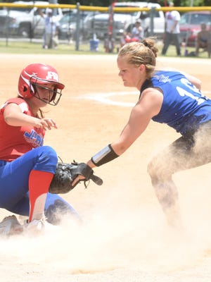 Mallorie Drewry of the Mountain Home Diamonds 14-and-under softball team tags a JPRD Westbank baserunner during the recent regional tournament at Keller Park.