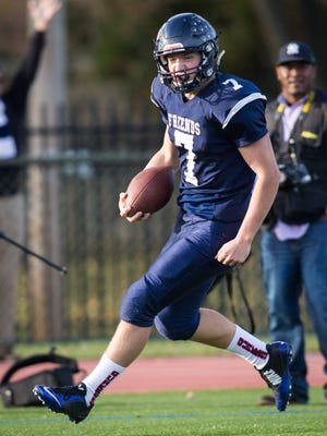 Wilmington Friends quarterback Justin Beneck, seen here against Howard, threw the go-ahead touchdown to lead the Quakers past Milford in Saturday's DII playoff quarterfinal game.