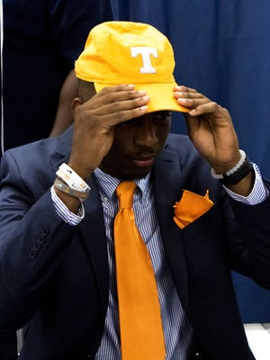 Tennessee recruit Trey Coleman puts a baseball cap on before signing his contract to play for the Volunteers during National Signing Day at West Monroe High School on Wednesday, February 1, 2017.