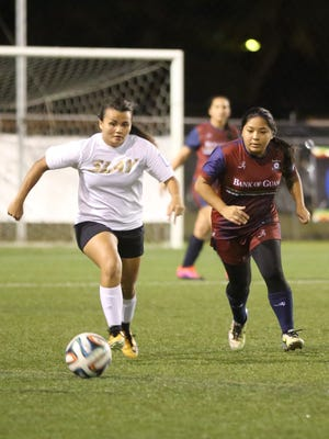 The Venue Slay's Raelene Tajalle and Bank of Guam Strykers W2's Levana Terlaje get into a foot race to the ball during a semifinal match of the W2 Division of the Bud Light Women's Soccer League Sunday at the Guam Football Association National Training Center. No. 1 The Venue Slay won 4-1 and will play against No. 2 The Venue Sidekicks in the division's championship match set for June 10.