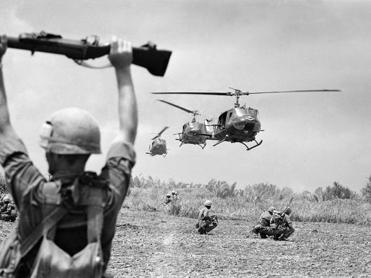 A U.S. soldier of the 9th Infantry Division uses an M79 grenade launcher to guide helicopters into an operation on the northern edge of South Vietnam's Mekong Delta in mid-July 1968.