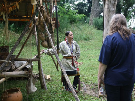 Jessica Diemer-Eaton from Shoals, Ind. demonstrates Native American ways of life during Clark Days at the Clark Cabin at the Falls of the Ohio State Park in Clarksville on Saturday.  (By Jenna Esarey, special to The Courier-Journal)  June 28, 2014.