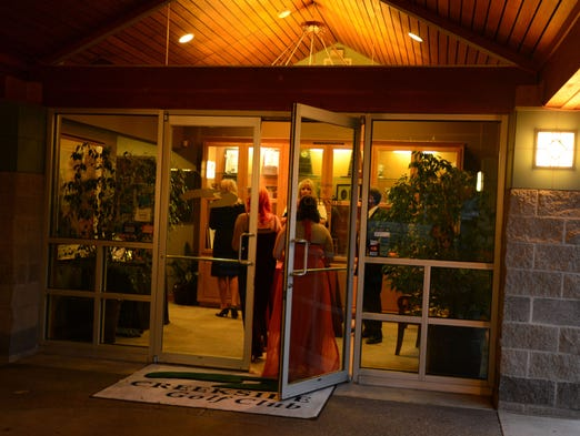 """Sprague High School students enjoy their prom at Creekside Golf Club in South Salem on Saturday, May 3, 2014. The theme was """"A Night in Paris."""""""
