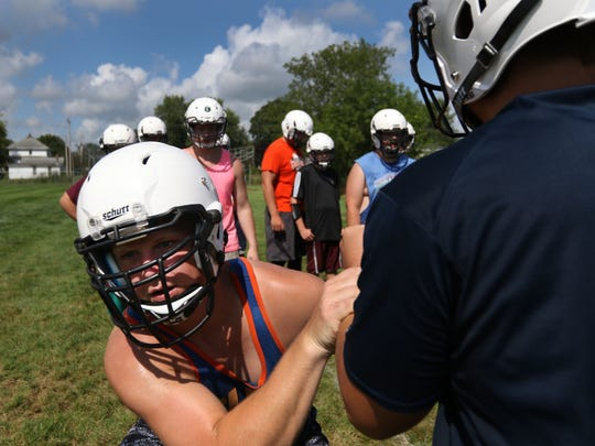 Stratford football players practice tackles at the school, August 3, 2016.