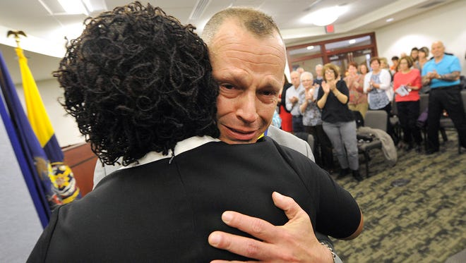 While getting a standing ovation, an emotional York City Police Detective Jeff Spence embraces mayor Kim Bracey after receiving the Mayor's Medal of Distinction at the York City Police Department's award ceremony in York City Council Chambers.