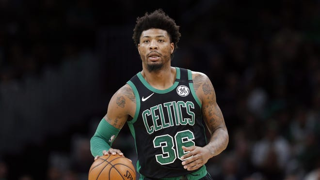After taking part in a conference call with former First Lady Michelle Obama, Boston's Marcus Smart has a message to deliver: Get out and vote.