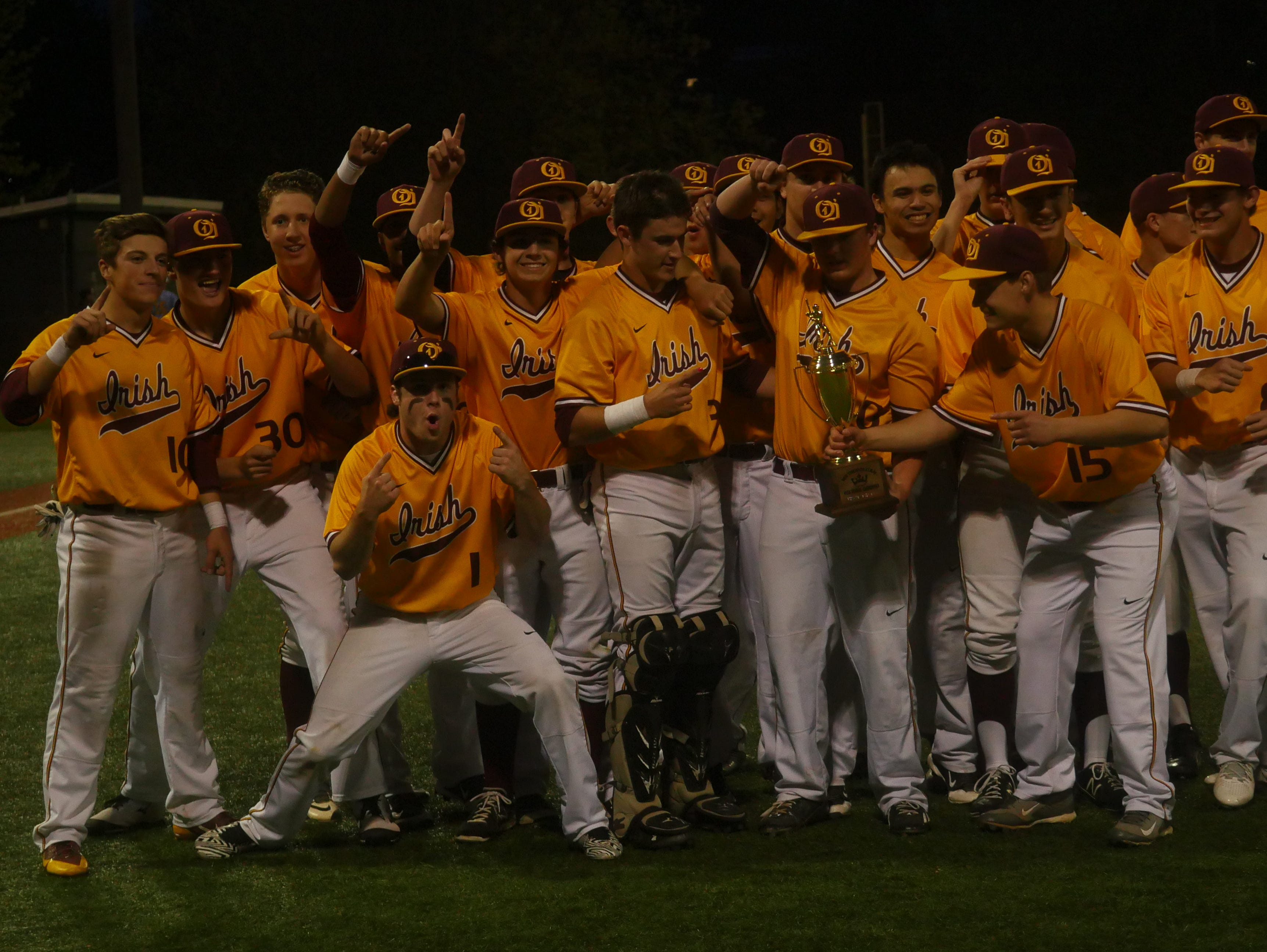 The O'Dea baseball team poses with its Metro League championship trophy.