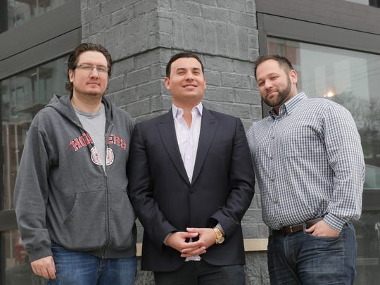 AFB Hospitality Group executive chef Derik Watson, from left, principal and owner Aaron F. Belen, and Director of Operations Scott Sadoff, outside the Morrie, a roadhouse-style restaurant coming to downtown Royal Oak this summer.