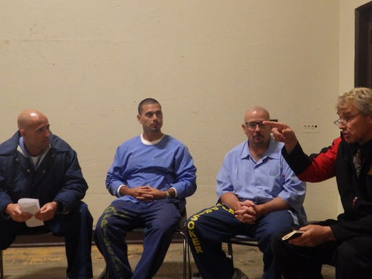 Jim Micheletti, minister at Palma High, makes a point during a group meeting with inmates at Soledad Prison.