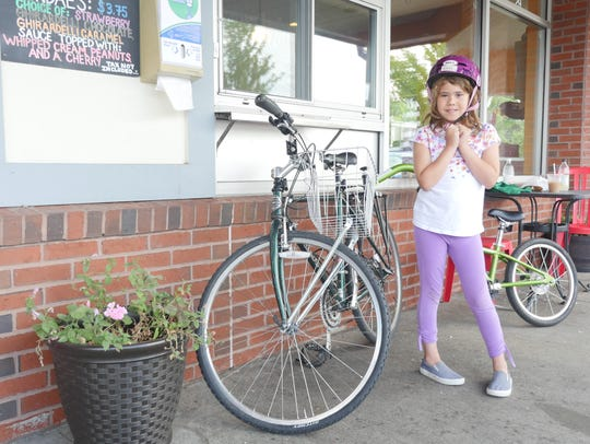 Sabine Brewer-Colie, 9, rode on the re-painted North