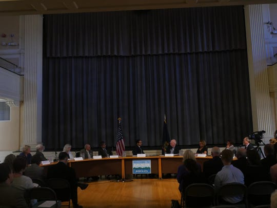 Sen. Patrick Leahy, Secretary Julian Castro and Mayor Miro Weinberger, sitting with state and local officials and nonprofit leaders, talk about state concerns and where Castro's Housing and Urban Development department could make an impact in Vermont.