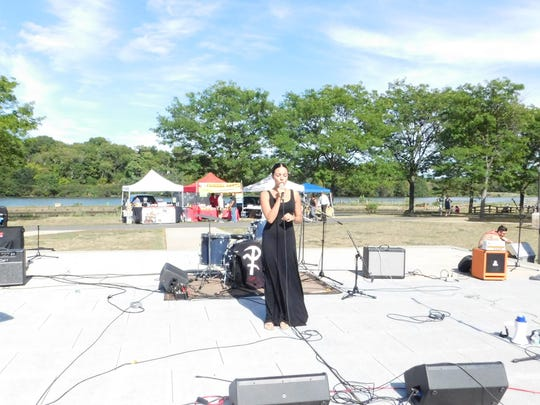 Danielle Illario sings the national anthem at Hub City Rocks on Sept. 11.