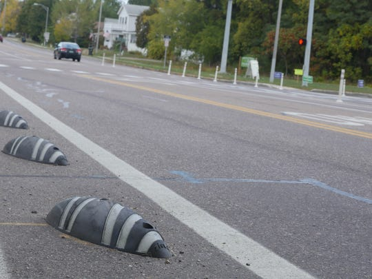 Bike lane protectors, also affectionately referred to as 'armadillos' are pictured here. Gaps between bike lane protectors have been increased to make way for emergency vehicles.