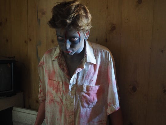 Jordan Friend plays a zombie at the Warriors Haunted Asylum in Dotyville in 2016.