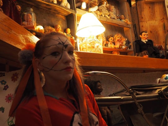 Lindzy Zwicke joins a collection of dolls in one of the rooms of the Warriors Haunted Asylum