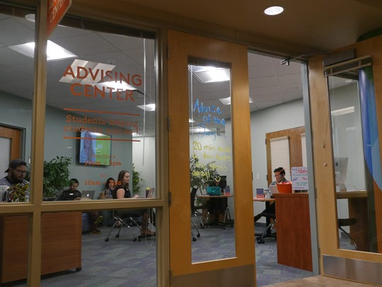 Student advisers work in a newly created advising center,