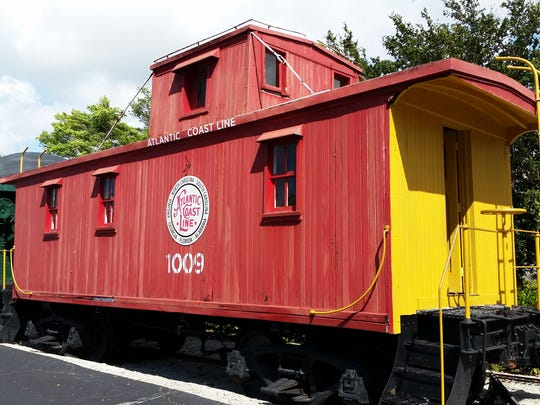 An Atlantic Coast Line caboose is on display at the