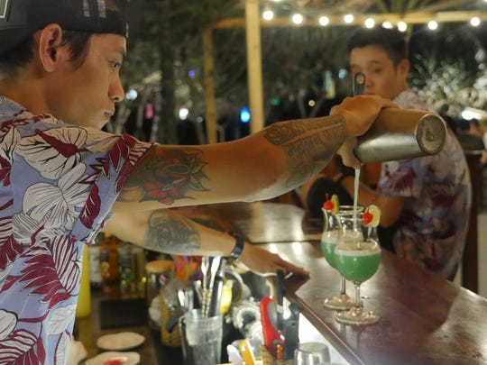 A bartender mixes a cocktail at the Sunset Beach bar on the Vietnamese island of Phu Quoc.