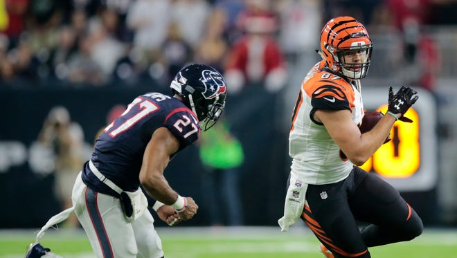 Cincinnati Bengals tight end C.J. Uzomah (87) turns upfield after making a catch in the second quarter during the Week 16 NFL game between the Houston Texans and the Cincinnati Bengals, Saturday, Dec. 24, 2016, at NRG Stadium in Houston, Texas. The Cincinnati Bengals lead 3-0 at halftime.