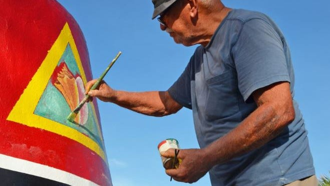 On Oct. 23, 2017, Danny Acosta puts the finishing touches on the conch shell on the Southernmost Point Buoy in Key West.