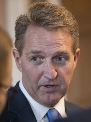 "Sen. Jeff Flake, R-Arizona, says we need to confront climate change. ""It gives urgency to what's going on right now."""