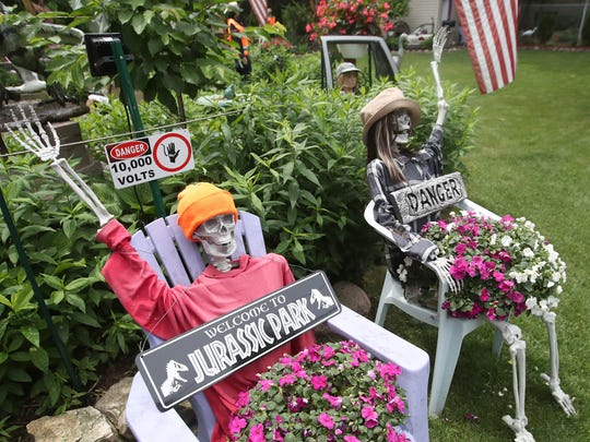Jim Brisbane displays his sense of humor at the entrance to the garden at his home on MacArthur Street in Allouez.