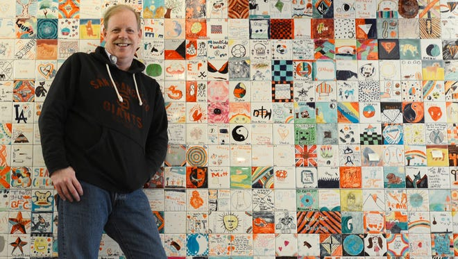 Since 1998, Jerry Moe has helped children from families affected by addiction through the Betty Ford Center. He stands here in front of tiles created by some of the children who've participated in the program.