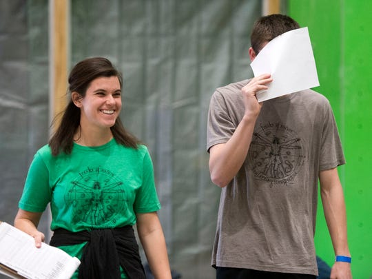 Lauren Stoffle of Knoxville leads Riley Baker of Maryville, who covers his eyes so as not to see the bouldering wall before his time begins, during a bouldering competition Saturday, Feb. 25, 2017, at Onsight Rock Gym in Knoxville.