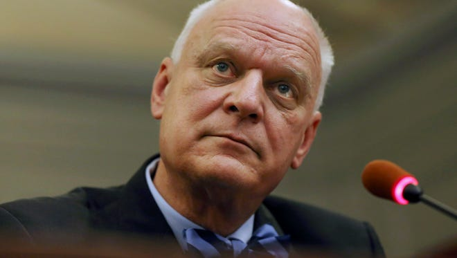 In this April 7, 2016, file photo, Atlantic City Mayor Don Guardian listens to a question as he addresses the New Jersey Assembly Judiciary Committee over the ongoing showdown over the future of Atlantic City, in Trenton, N.J. Guardian is poised to announce Monday, May 2, whether the seaside gambling resort will make a $1.8 million bond payment.