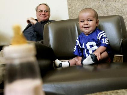 During a layover in Dallas on his way home to Afghanistan on April 11, 2005, Qudrat was all smiles as he spotted his bottle. After intricate heart surgery, he thrived -- and loved to eat. And he looked darned good in a Colts baby jersey.