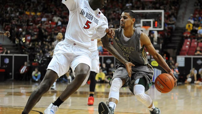 CSU's Gian Clavell drives against San Diego State's Dwayne Polee II during a semifinal game in last year's Mountain West men's basketball tournament at the Thomas & Mack Center in Las Vegas. The MW's board of directors decided Friday to trim the men's and women's basketball tournaments to the top eight teams, beginning in 2017, and to continue to hold the tournaments at the Thomas & Mack Center through 2019.