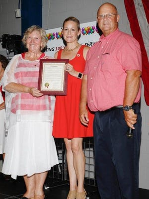 """Beth Leggett and Rachel Hepner-Zawodny and Commissioner James Sass celebrate the proclamation of July 23, 2017, as """"American Red Cross Day"""" in Ottawa County."""