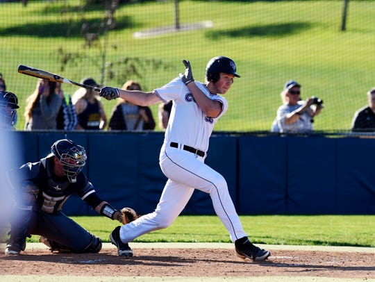 Josh Rehwaldt (36) bats for USF as they play Augie
