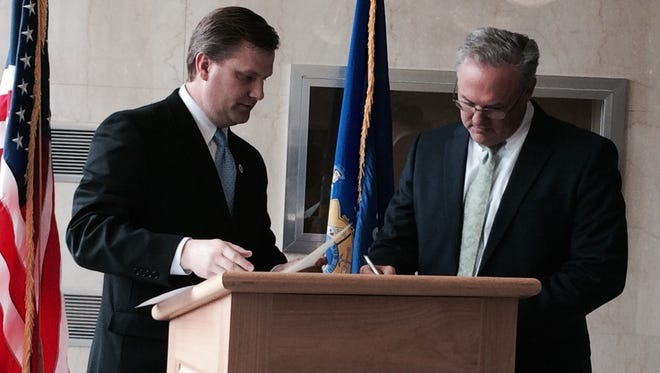 Shaun Morrow signs his oath of office at a swearing in ceremony Tuesday, held in the lobby of the Portage County Courthouse.