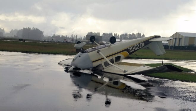 Damage to planes at the Aurora Airport following a possible tornado touchdown October 12, 2017.