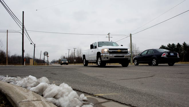 Vehicles pass Thursday, Dec. 31, 2015 at Range and Griswold Roads in Kimball Township. Construction of a roundabout at the intersection could begin as soon as May.