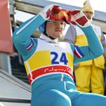 """This image released by 20th Century Fox, Taron Egerton portrays Eddie Edwards in a scene from """"Eddie the Eagle."""" (Larry Horricks/20th Century Fox via AP)"""
