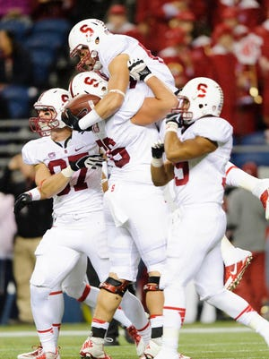 Stanford Cardinal guard Kevin Danser (76) hugs wide receiver Devon Cajuste (89) after Cajuste caught a pass and ran it in for a touchdown against the Washington State Cougars.