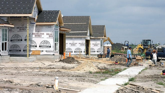 CALLER-TIMES FILE PHOTO Contract workers construct new homes in the Rancho Vista subdivision Monday. The City Council is slated to talk about the proposed Plan CC in upcoming weeks.