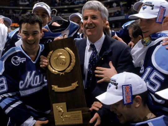 Shawn Walsh, middle, holds the 1999 NCAA championship trophy with Steve Kariya (18). Walsh died in 2001 from kidney cancer. His son, Travis Walsh, is finishing his senior season at MSU.