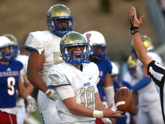 Reed's Cameron Emerson (10) celebrates after scoring
