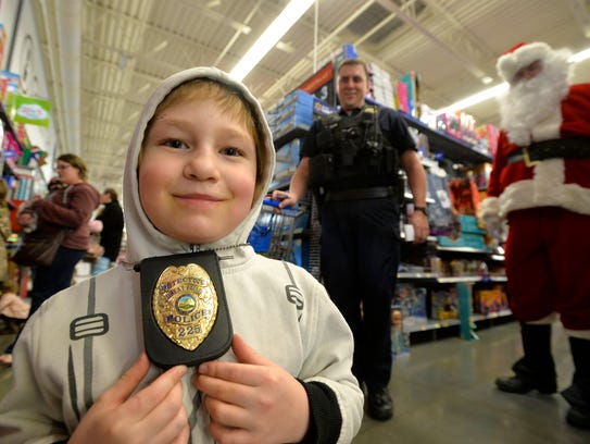Liam Noya, age 8, shops with Great Falls police detective