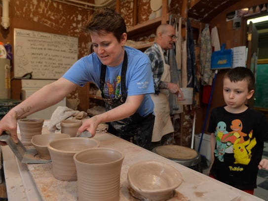 Stephanie DiGiulio and her son Eli place their clay