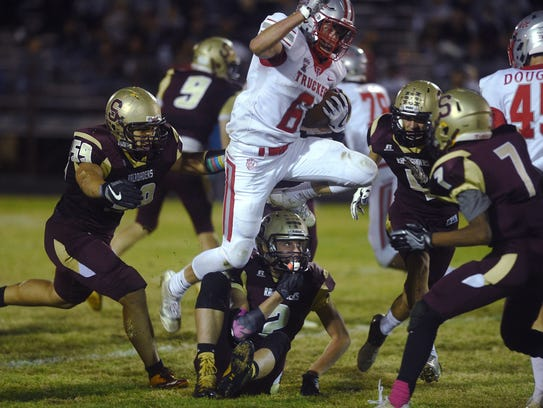 Truckee's Cole Eichele (6) runs over the Sparks defense