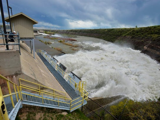 Rainbow Dam overflow gates are open letting out about