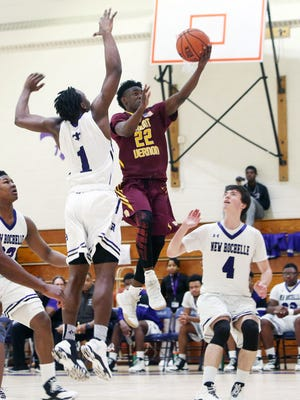 Mt. Vernon's Demetre Roberts (22) drives to the basket in front of New Rochelle's Jaylin McGhee (1) during boys basketball action at New Rochelle High School Jan. 21, 2017. Mt. Vernon won the game 71-46.