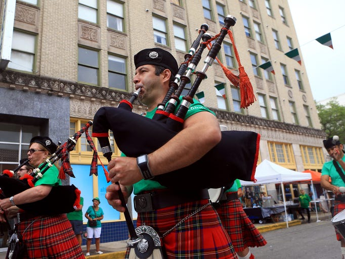 Members of the Water's Edge Pipes & Drums perform during
