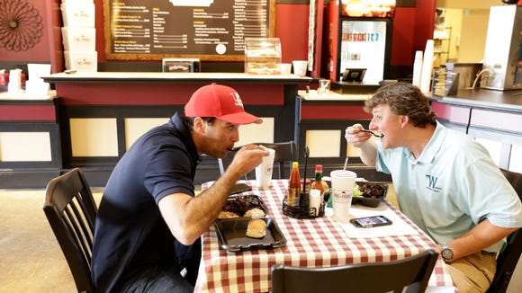 Jason Trotter, left, and Lee Womack enjoy lunch at newly-opened Pot & Paddle in Lafayette Mon., March 20, 2017.